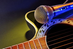 Free Acoustic Guitar And Microphone Isolated With Yellow And Blue Lig Royalty Free Stock Images - 81200669