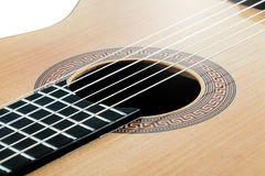 Acoustic guitar with an antique ornament and light wood closeup Stock Photography