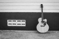 Acoustic guitar on background black and white Royalty Free Stock Photography