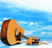 Acoustic guitar on the beach Royalty Free Stock Images
