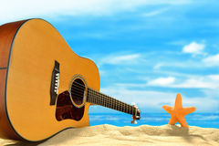 Acoustic guitar on the beach Stock Photography