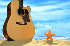 Acoustic guitar on the beach Stock Image
