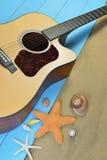 Acoustic guitar on the beach Royalty Free Stock Photos