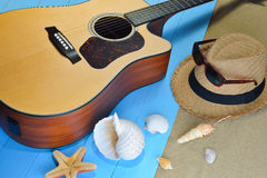 Acoustic guitar on the beach Stock Photo