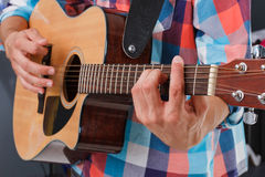 Acoustic guitar being played. Stock Photo