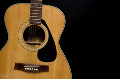 Acoustic Guitar on Black. Background Royalty Free Stock Images