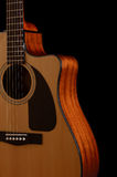 Acoustic guitar on a black background Stock Photos