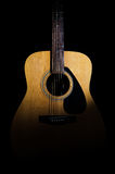 Acoustic guitar on a black background. Close-up Royalty Free Stock Photos