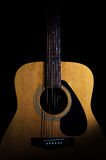 Acoustic guitar on black background. Close-up Royalty Free Stock Image
