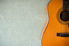 Acoustic guitar on a blank background Royalty Free Stock Photography