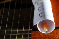 Acoustic guitar, blank music notes, pencil. Creative set of acoustic guitar, blank music notes and pencil Stock Image