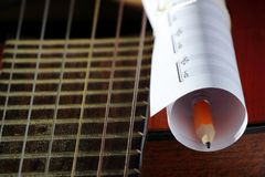 Acoustic guitar, blank music notes, pencil. Creative set of acoustic guitar, blank music notes and pencil Stock Photo