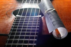 Acoustic guitar, blank music notes, pencil. Creative set of acoustic guitar, blank music notes and pencil Royalty Free Stock Photography