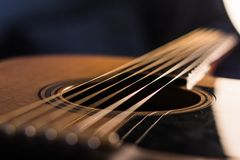 Acoustic guitar body and strings close up royalty free stock photos
