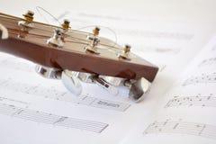Acoustic guitar. An acoustic guitar on a guitar book Stock Photo