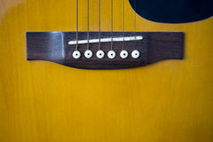 Acoustic Guitar Bridge. Saddle and bridge of an acoustic guitar Royalty Free Stock Photography