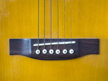 Acoustic guitar bridge. Saddle and bridge of an acoustic guitar Stock Photos