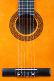 Acoustic guitar bridge and strings close-up Stock Photos