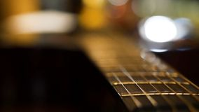 Acoustic guitar bridge and strings close up. Close-up of guitar strings. Elegant guitar.  royalty free stock image