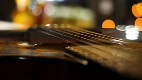 Acoustic guitar bridge and strings close up. Close-up of guitar strings. Elegant guitar.  stock photo