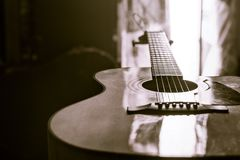 Acoustic guitar close-up on a beautiful colored background stock photo