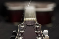 Acoustic guitar. Close-up, shallow depth of field Royalty Free Stock Photography