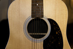 Acoustic Guitar. Close up of the sound hole and pick guard of an acoustic guitar Stock Photography
