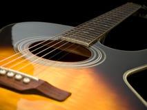 Acoustic guitar closeup royalty free stock photography