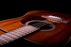 Acoustic Guitar Closeup. A closeup photo of an acoustic guitar featuring its body, fretboard and soundhole Stock Photo