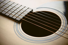 Acoustic guitar. Closeup shot photo of the acoustic guitar stock photography