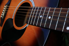 Acoustic Guitar. Closeup of a six string acoustic guitar stock photo