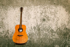 Acoustic guitar detail against a grungy background Royalty Free Stock Images