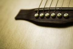 Acoustic Guitar Detailed Saddle and Bridge Royalty Free Stock Images