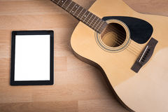 Acoustic guitar with digital tablet Stock Photo