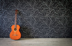Acoustic guitar in empty room. Background Royalty Free Stock Images