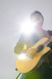 Acoustic guitar in feeling. Royalty Free Stock Image