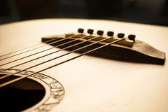 Acoustic guitar focus on bridge and strings Stock Photo