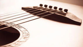 Acoustic guitar focus on bridge and strings Stock Photography