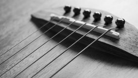 Acoustic guitar focus on strings Stock Images