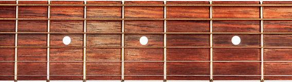 Acoustic guitar fretboard background. Acoustic guitar fretboard photographed as background Stock Images