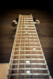 Acoustic guitar fretboard. Photo taken in perspective royalty free stock image