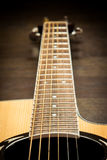 Acoustic guitar fretboard. Photo taken  in perspective Royalty Free Stock Photography