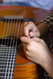 Acoustic guitar and girl's's hands Royalty Free Stock Photography