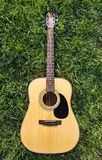 Acoustic Guitar on the grass.  Royalty Free Stock Photos