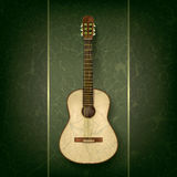 Acoustic guitar on grunge green background Royalty Free Stock Photography