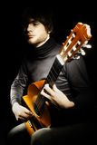 Acoustic guitar guitarist player Stock Image