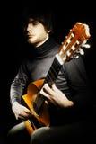 Acoustic guitar guitarist player Stock Image