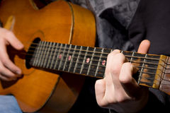 Acoustic guitar guitarist playing Royalty Free Stock Photo