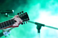 Acoustic guitar. Guitarist playing guitar in concert Stock Photo