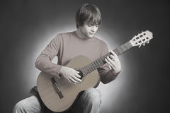 Acoustic guitar guitarist playing Stock Image